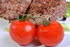 Peppered lamb grill steak and organic tomato Royalty Free Stock Images