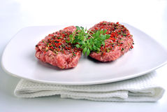 Peppered lamb grill steak on a white plate Royalty Free Stock Photo