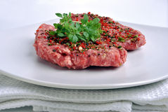 peppered lamb grill steak on a white plate Stock Images