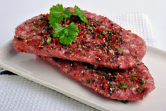peppered lamb grill steak on a white plate Royalty Free Stock Images