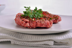 Peppered lamb grill steak on a white plate Royalty Free Stock Photos