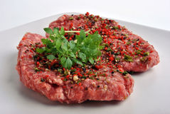 peppered lamb grill steak on a white plate Royalty Free Stock Image
