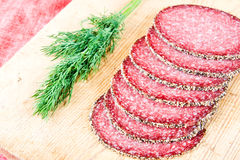 Peppered salami with dill Stock Images