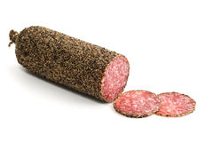 Peppered salami sausage and slices Royalty Free Stock Image