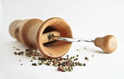 Peppermill with peppercorns Stock Image
