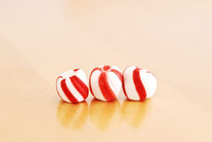 Peppermint Balls. Peppermint Candy Cane Balls On Wood royalty free stock photography