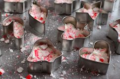 Peppermint bark in mini cookie cutters Christmas shapes Royalty Free Stock Photos