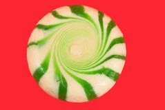 Peppermint candies. Green peppermint candy isolated on red background Royalty Free Stock Images
