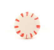Peppermint Candy. A macro shot of a peppermint candy over a white background Royalty Free Stock Photography