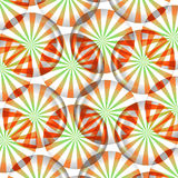 Peppermint Candy Background. Pattern of red, green and white striped round peppermint candy wallpaper background  on white background Royalty Free Stock Photos