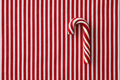 Peppermint candy cane on striped background Royalty Free Stock Photography