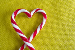Peppermint Candy Canes in Heart Shape on textile background Stock Image