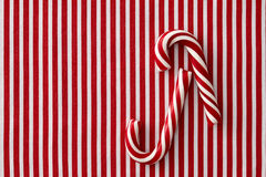 Peppermint candy canes on striped background Stock Photography