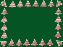 Peppermint Candy Frame. Peppermint and spearmint candy Christmas trees on green background Royalty Free Stock Photo