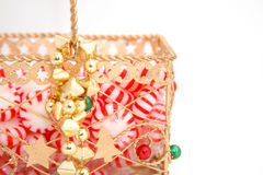 Peppermint Candy Gold Basket. Round peppermint candies in a gold basket Royalty Free Stock Photos