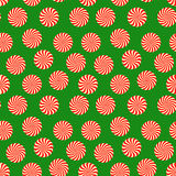 Peppermint candy seamless pattern on green background. Christmas and New Year holiday wrapping paper Royalty Free Stock Photo