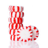 Peppermint candy tower  on white. Red striped peppermint Christmas candy Stock Photography