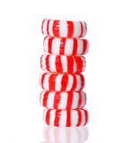 Peppermint candy tower  on white. Red striped peppermint Christmas candy Royalty Free Stock Photos
