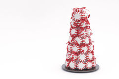 Peppermint Christmas Tree. Christmas Tree Decoration Isolated on White with Copy Space to the Left Royalty Free Stock Photo