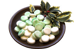 Peppermint creams. Plate of marbled green & white peppermint creams, home-made for Christmas Royalty Free Stock Photography