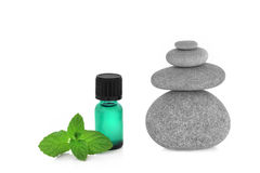 Peppermint Essence and Spa Stones Royalty Free Stock Image