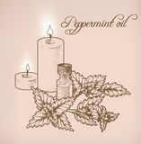 Peppermint essential oil and candles Royalty Free Stock Photos