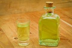 Peppermint liqueur bottle and shot Stock Photo