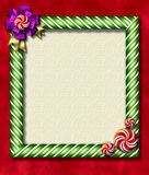 Peppermint x-mas frame. Beautiful holiday candy cane frame festooned with a big bow & peppermints Stock Photos