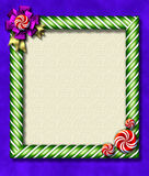 Peppermint x-mas frame. Beautiful holiday candy cane frame festooned with a big bow & peppermints Stock Image