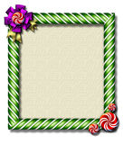 Peppermint x-mas frame. Beautiful holiday candy cane frame festooned with a big bow & peppermints Royalty Free Stock Images