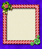 Peppermint x-mas frame. Beautiful holiday candy cane frame festooned with a big bow & peppermints Royalty Free Stock Photos