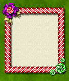 Peppermint x-mas frame. Beautiful holiday candy cane frame festooned with a big bow & peppermints Stock Photography