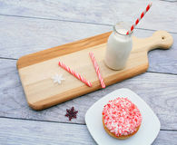 Peppermint stick dough nut on plate with milk Stock Image