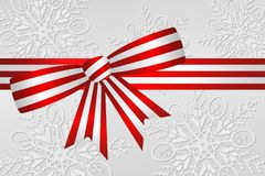 Peppermint Stripe Ribbon. Red and white peppermint stripe Christmas ribbon bow with silver and white snowflake background vector illustration