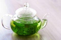 Peppermint tea on a table. Peppermint tea in glass pot on the table Stock Photos