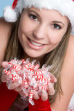 peppermints κοριτσιών Χριστουγένν&omeg Στοκ Φωτογραφία