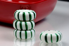 Peppermints. Close-up of green and white striped peppermint candies stock photos
