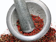 PeppermiX. Fresh Pepper are worked on in the mortar royalty free stock photo