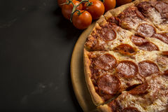 Pepperoni and cheese Pizza and tomatoes with copy area Stock Images