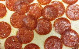 Pepperoni on Cheese Royalty Free Stock Photos