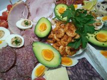 Close up of tangy prawns on a  cheese platter. With pepperoni, chorizo, ham, egg Stock Photography