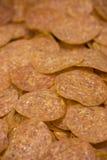 Pepperoni coupées en tranches fraîches Images stock