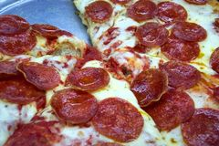 Pepperoni Lover's Pizza. Photo of pepperoni pizza at a food court Stock Photos