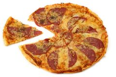 Pepperoni with one piece out Royalty Free Stock Photography