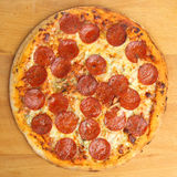 Pepperoni Pizza. Thin-crust pepperoni pizza photographed from overhead Stock Photos