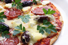 Pepperoni Pizza. Home-made pepperoni pizza, bubbling and ready to eat royalty free stock photo