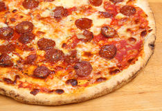 Pepperoni Pizza. Close-up of thin-crust pepperoni pizza Royalty Free Stock Image