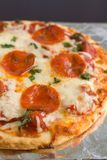 Pepperoni Pizza. With mozzarella cheese and parsley fresh out of the oven Royalty Free Stock Photography