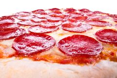 Pepperoni pizza. Pizza with sausage, cheese on a white background Royalty Free Stock Images
