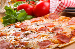 Pepperoni pizza. And fresh vegetables stock photos